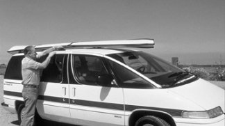 Rigid-hulled inflatable on top of the car