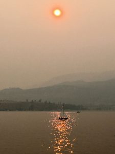 Forest fires raged around Kelowna, British Columbia, last year and during that time, Paul Skene captured this smoke-on-the-water-effect shot of a lone sailboat on Okanagan Lake.