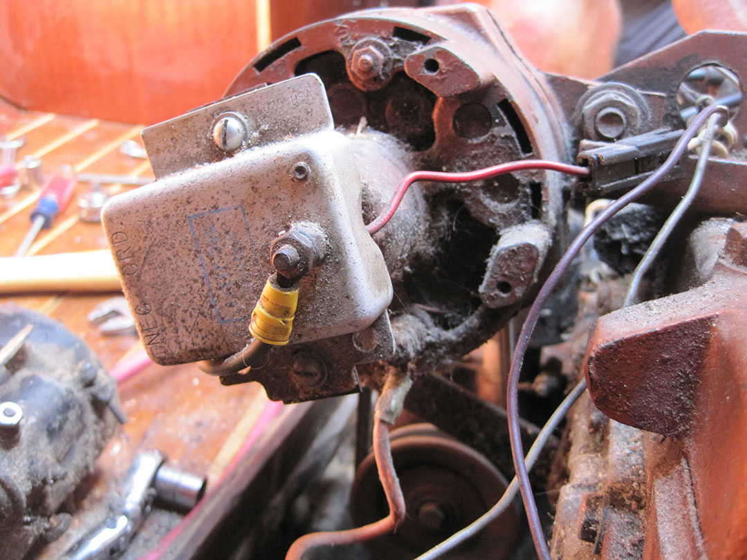The regulator is attached to the back of the alternator for the Atomic 4 engine.