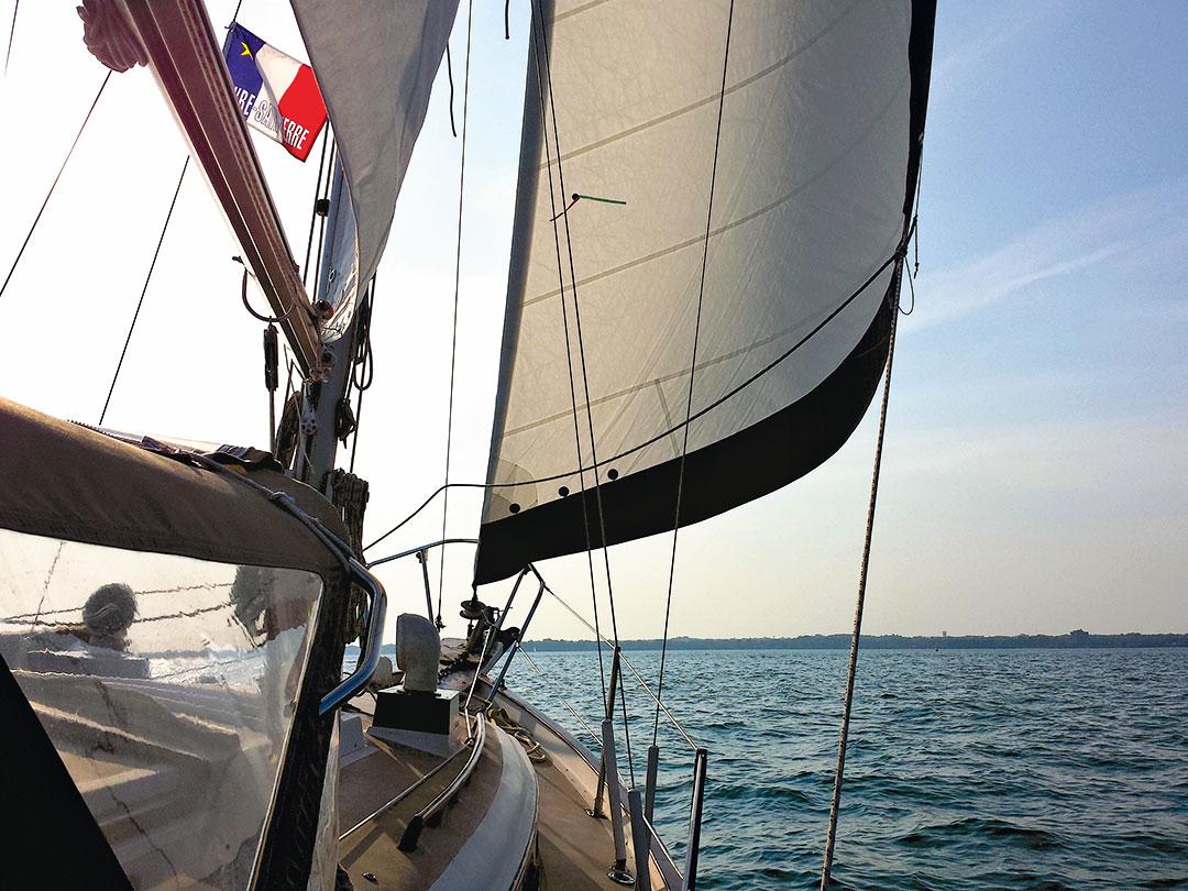 Sailing toward Point Claire Yacht Club