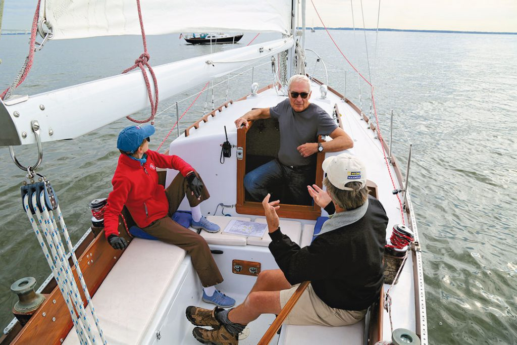 sailboat crew discussing strategy