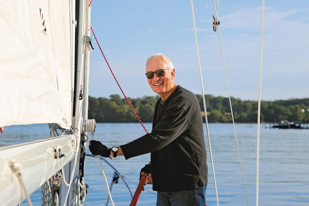 John Weber raising sailboat main