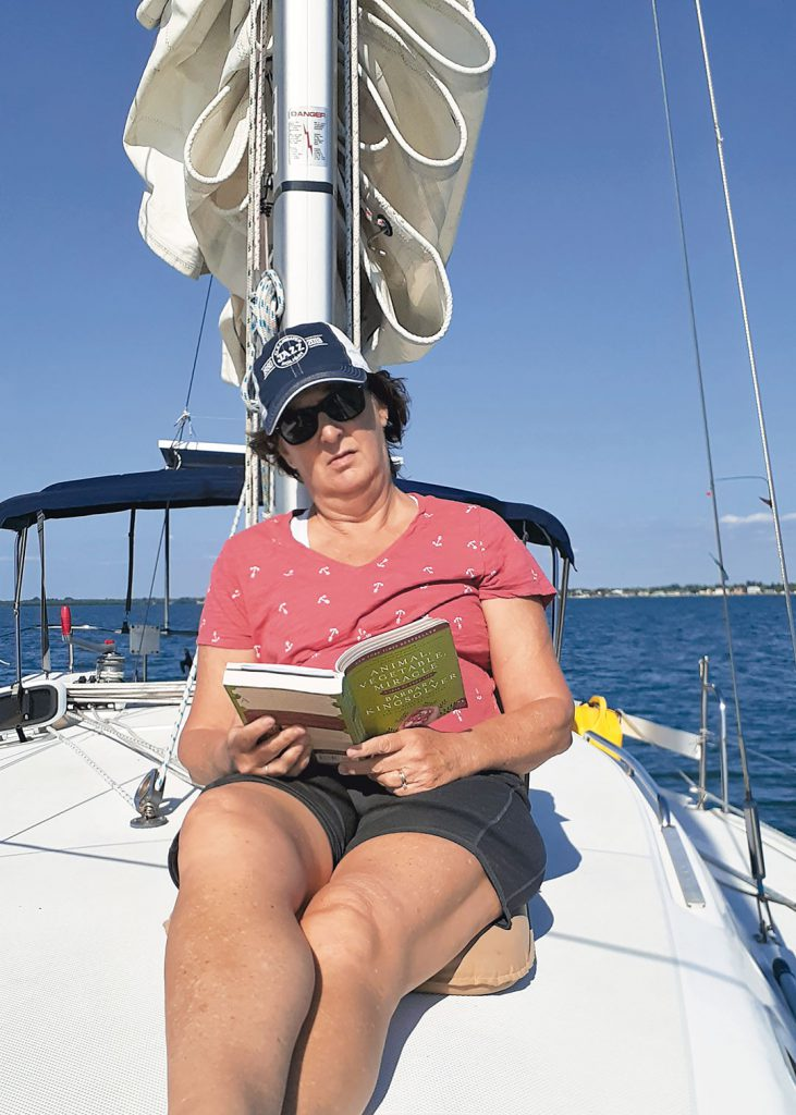 Reading a book on a sailboat