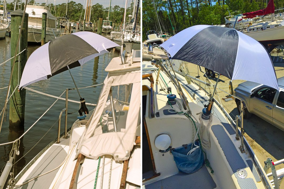 an umbrella mounted to a sailboat cockpit provides much needed shade.