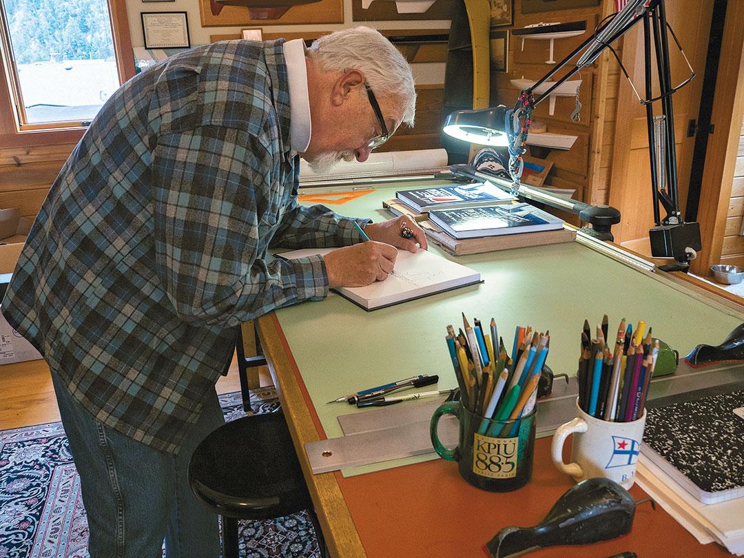 Bob Perry boats designer signing a book