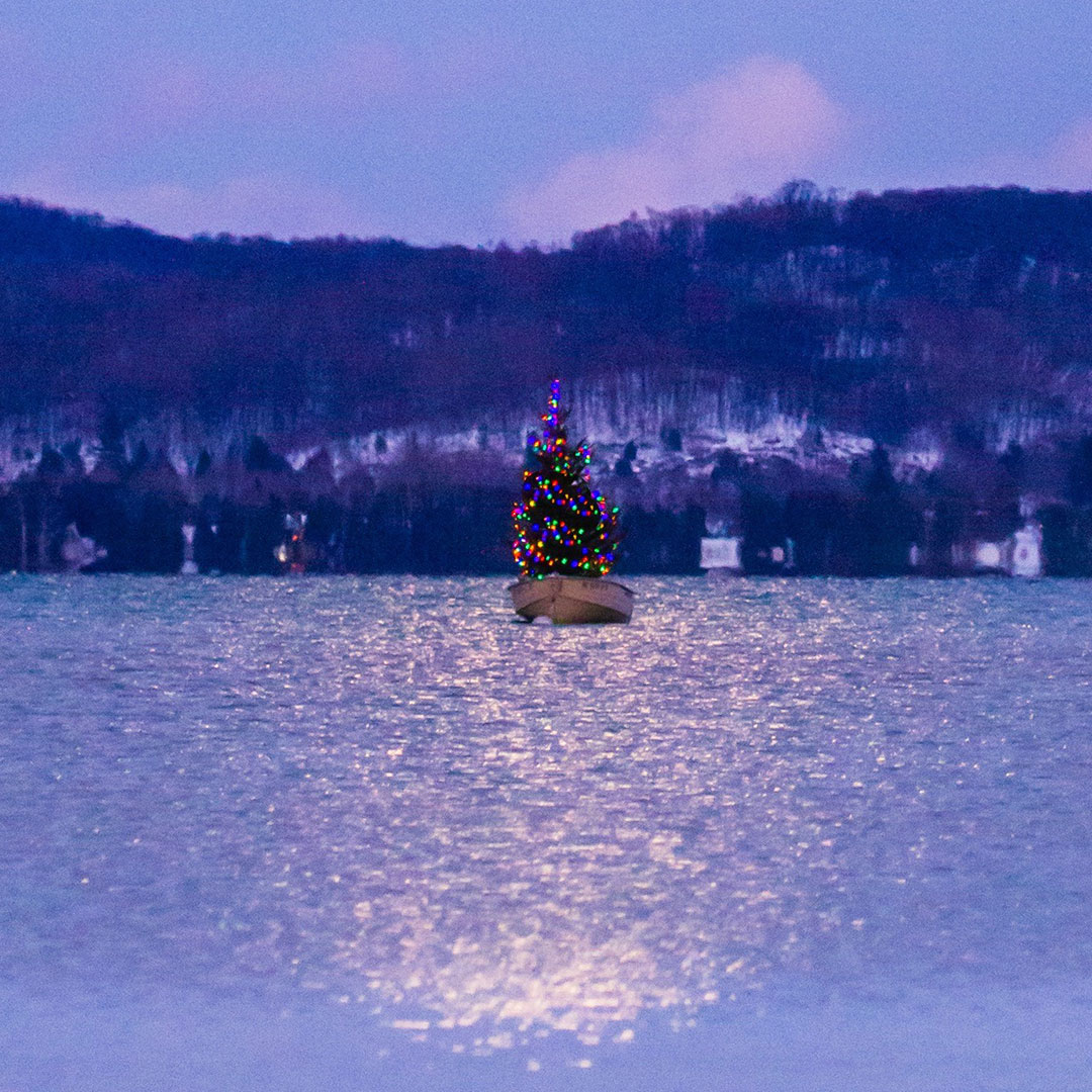floating christmas tree in a canoe on the lake